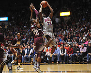 "Ole Miss' Jarvis Summers (32) vs. Mississippi State's Craig Sword (32) at the C.M. ""Tad"" Smith Coliseum on Wednesday, February 6, 2013. (AP Photo/Oxford Eagle, Bruce Newman).."