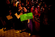 A young Barack Obama supporter holds a sign for the Democratic presidential candidate during a town hall event at San Jose State University Sunday, Feb. 3, 2008 in San Jose, Calif.
