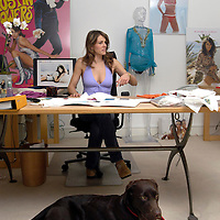 "Elizabeth Hurley with her swimwear designs in her studio in South Kensington, London, UK. Sold exclusively in Harrods and Saks in New York. Also featured in the shot is Liz's dog ""Lucy""."