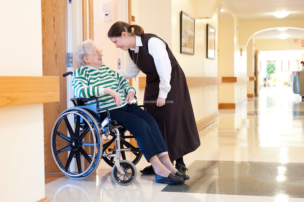 Elizabeth Reisser, a Carmelite postulant, shared a laugh with St. Agnes Home resident Mary Eckert. Reisser, from Cincinnati, serves much of her time working at the residence as well as the Carmelite Child Care Development Center. Last fall, the Carmelite sisters kicked off a year's worth of celebrations marking their 90th jubilee in St. Louis. St. Agens Home will celebrate its 75th anniversary this year, and the Carmelite Chld Care Development Center marks its 25th anniversary.
