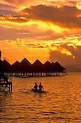 Image of overwater bungalows with kayakers on Bora Bora, Tahiti, French Polynesia