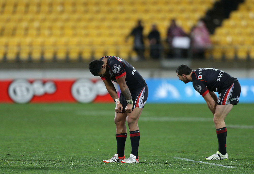 A dejected Ken Maumalo, left, and Jonathan Wright of the New Zealand Warriors after losing top the Dragons in their round 22 NRL match at Westpac  Stadium, Wellington on  Saturday, August 08, 2015. Credit: SNPA / David Rowland