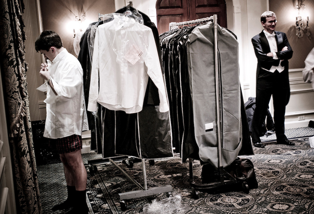 Young escorts getting dressed at the Waldorf Astoria Hotel to get ready for the ball...The Viennese Opera Ball in New York City is the biggest and most famous of New York's charity balls. Held yearly at the Waldorf Astoria hotel and opened by debutantes and their escorts.