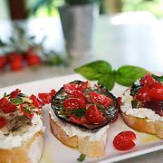 Tomato, Eggplant and Artichoke Bruschetta on White Plate