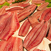 "Fresh fish filets are sold at the Rialto Pescheria, fish market. Venice (Venezia) is the capital of Italy's Veneto region, named for the ancient Veneti people from the 10th century BC. The romantic ""City of Canals"" stretches across 117 small islands in the marshy Venetian Lagoon along the Adriatic Sea in northeast Italy, Europe. The Republic of Venice wielded major sea power during the Middle Ages, Crusades, and Renaissance. Venice and the Venetian Lagoon are honored on UNESCO's World Heritage List."