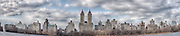This is a panoramic shot of New York's Upper West side from a view across the Central Park Reservoir.
