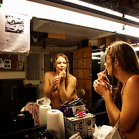 """Anya"" applies makeup while preparing for her turn to dance at the world famous Mons Venus strip club in Tampa, Florida."