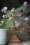 A cross and flowers at the entrance to the cave where the body of Lucy Blackman was found, Aburatsubo beach, near Tokyo, Japan on Monday, April 23rd 2007.  The verdict will be announced in the trial of Joji Obara for Lucy Blackman's murder (and rapes of other women) on Tuesday April 24th 2007,