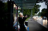 A woman prepares her make-up at a bustop in Tallinn, Estonia in Sept. 2009. The young democracy joined the European Union in 2004 and since has been working on getting the euro as its national currency. Estonia has one of the highest per capita incomes in central europe.