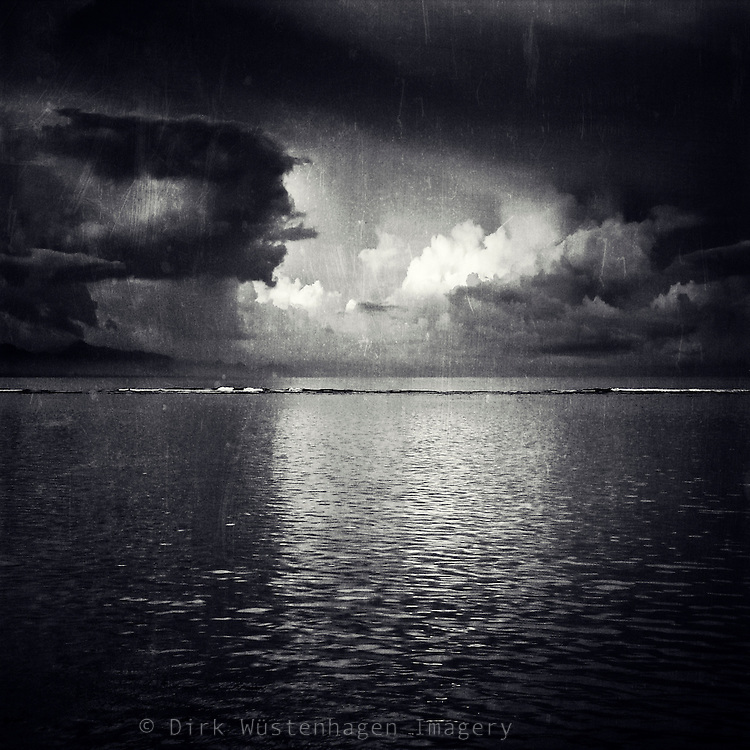 Thunderstorm over the Indic Ocean with the light of the rising sun reflecting on clouds. <br /> <br /> Prints &amp; more: http://society6.com/DirkWuestenhagenImagery/eClipse-Ttg_Print