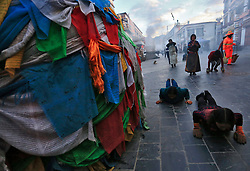 A picture made available on 19 September 2016 of Tibetan pilgrims praying and prostrating outside the Jokhang Temple in the early morning in Lhasa, Tibet Autonomous Region, China, 10 September 2016. Jokhang Temple is considered one of the most sacred site for Tibetan buddhists built during the rule of King Songtsen Gampo in the 7th century.