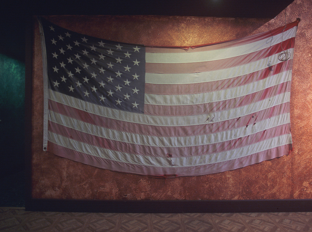 Tattered and fadded American flag hangs at Rhawn Street Studios in Philadelphia, Pennsylvania