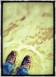 "Boots in the water on the beach at New Castle Common, New Castle, New Hampshire. iPhone photo - suitable for print reproduction up o 8"" x 12""."