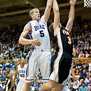 3 November 2009: Dukes #5 Mason Plumlee Rejects a shot..The Duke Blue Devils defeat the Findlay Oilers 84 -48 in an exhibition game. Kyle Singler had 20 points as Duke wraps up it's pre-season.. Mandatory Credit:Mark Abbott / Southcreek Global