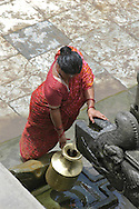 Patan's Durbar Square. Patan. , People collecting water from a public fountain., Sadhu. B1276