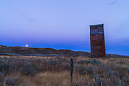 The old grain elevator at Dorothy, Alberta and the Full Harvest Moon, Sept 29, 2012. Shows the Belt of Venus pink glow above the blue shadow of the Earth. Taken as part of a 400-frame time-lapse sequence. With Canon 5D MkII and 16-35mm lens. Exposure with Little Bramper intervalometer.
