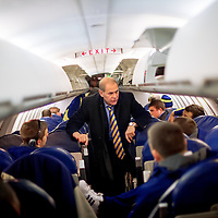 ANN ARBOR, MI -- February 4, 2013 -- University of Michigan head coach John Beilein talks to his team in the back of the team plane after landing in Michigan after their loss to the Indiana University Hoosiers.(PHOTO / CHIP LITHERLAND)