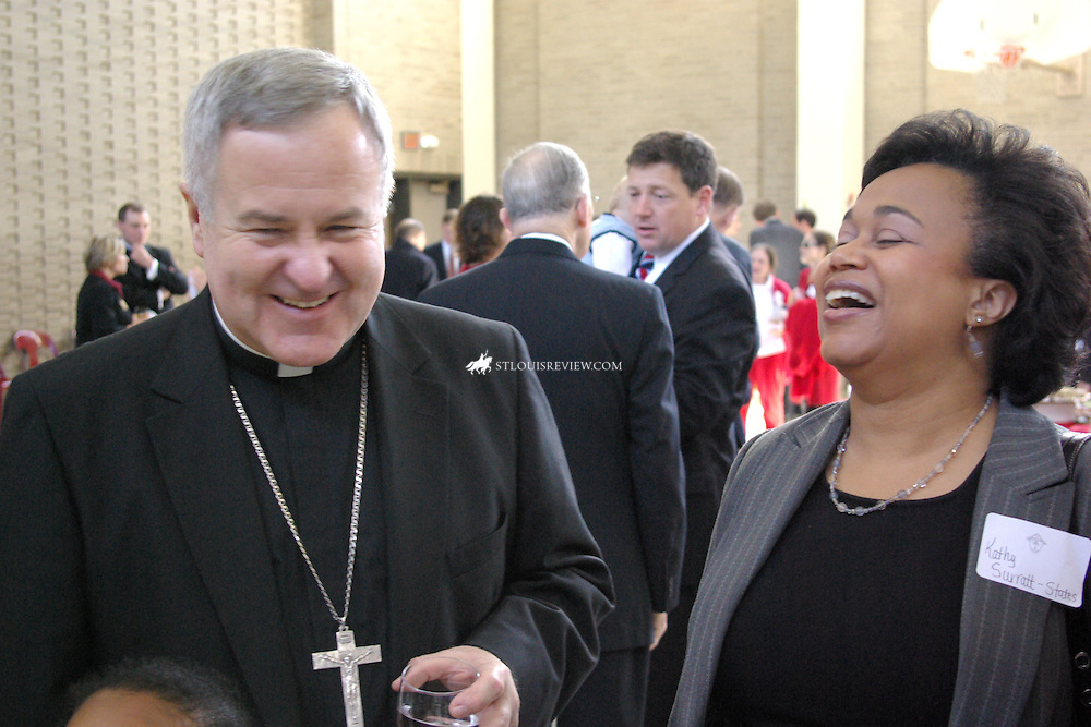 Archbishop Robert J. Carlson shared a laugh with Judge Kathy Surratt-States of the Bankruptcy Court for the Eastern District of Missouri during a reception Oct. 4 in Boland Hall after the Red Mass at Cathedral Basilica of St. Louis.