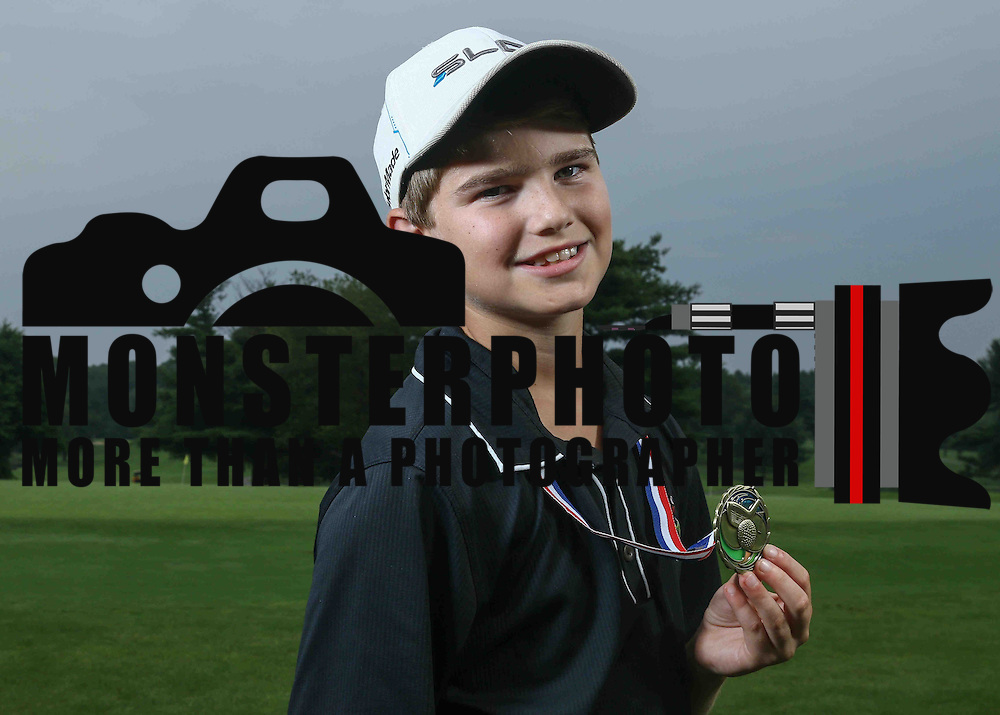 Evan Barbin (11) of Elkton, MD, poses for a photo after winning the twelve and under division at Chesapeake Bay Golf Club Thursday, July 03, 2015, in Rising Sun, Maryland.