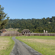 """Fort Ross State Historic Park preserves a former Russian colony (1812-1842) on the west coast of North America, in what is now Sonoma County, California, USA. Stockade walls were reconstructed several times from 1929-1997. Visit Fort Ross and dramatic coastal scenery 11 miles north of Jenner on California Highway One. Initially, sea otter pelts funded Russian expansion, but by 1820, overhunting motivated the Russian-American Company to introduce moratoriums on hunting seals and otters, the first marine-mammal conservation laws in the Pacific. Russian voyages greatly expanded California's scientific knowledge. For centuries before Europeans arrived, this site was called Metini and had been occupied by the Kashaya band of Pomo people who wove intricate baskets and harvested sea life, plants, acorns, deer, and small mammals. Sponsored by the Russian Empire, """"Settlement Ross"""" was multicultural, built mostly by Alaskan Alutiiq natives and occupied by a few Russians and 300-400 native Siberians, Alaskans, Hawaiians, Californians, and mixed Europeans. Renamed """"Ross"""" in 1812 in honor of Imperial Russian (Rossiia), Fortress Ross was intended to grow wheat and other crops to feed Russians living in Alaska, but after 30 years was found to be unsustainable. Fort Ross was sold to John Sutter in 1841, and his trusted assistant John Bidwell transported its hardware and animals to Sutter's Fort in the Sacramento Valley. Fort Ross is a landmark in European imperialism, which brought Spanish expanding west across the Atlantic Ocean and Russians spreading east across Siberia and the Pacific Ocean. In the early 1800s, Russians coming from the north met Spanish coming from the south along the Pacific Coast of California, followed by the USA arriving from the east in 1846 for the Mexican-American War. Today, Fort Ross is a California Historical Landmark and a National Historic Landmark."""