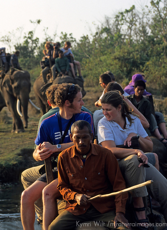 Asia, Nepal, Chitwan National Park. Elephant back safari riders
