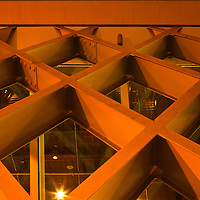 WA10115-00...WASHINGTON - Night view of the outside walkway at the downtown branch of the Seattle Public Library.