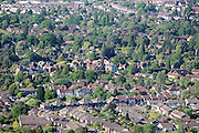 Suburban houses and tree lined streets south edge of Cheltenham Spa Town, Gloucestershire. Aerial view seen from Leckhampton Hill