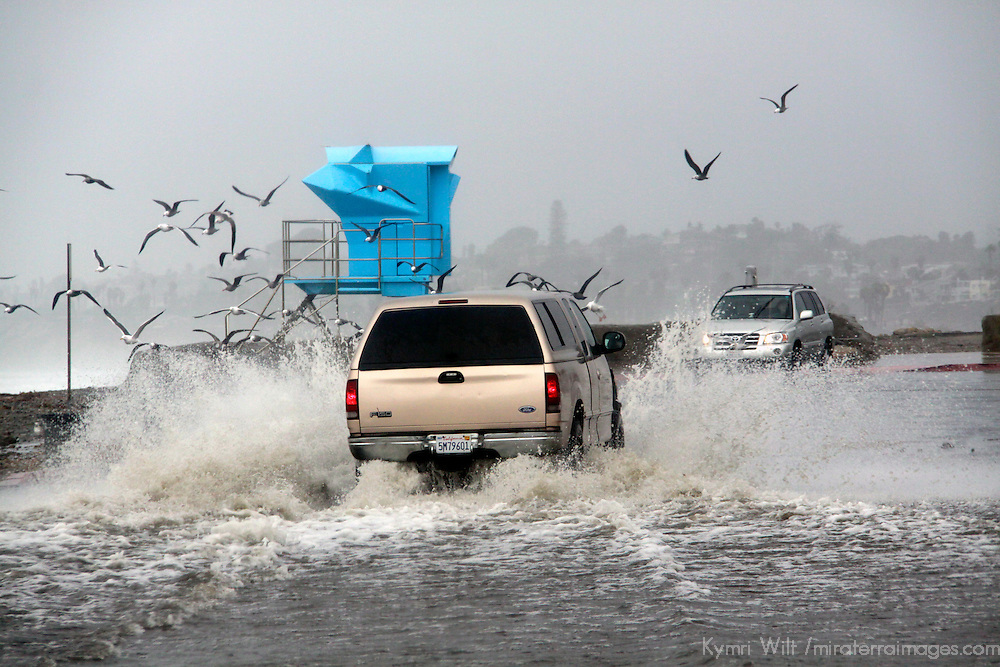 USA, California, Cardiff by the Sea. A beach parking lot floods during extreme high tide in winter.