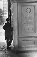 Young male student of Eton College outside the gates of the school in Windsor.