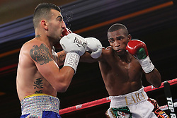 November 10, 2012; Las Vegas, NV; USA; Vanes Martirosyan and Erislandy Lara during their HBO Boxing after Dark main event at the Wynn Resort and Casino.  Photo: Ed Mulholland/HBO; HBO USAGE ONLY