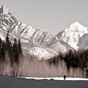 man photographing glacier national park winter scene