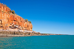 Dramatic red cliffs line Hanover Bay.