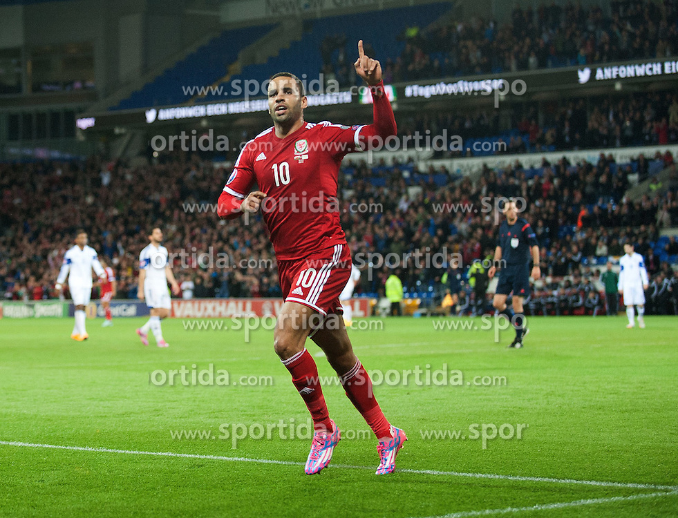 13.10.2014, City Stadium, Cardiff, WAL, UEFA Euro Qualifikation, Wales vs Zypern, Gruppe B, im Bild Wales Hal Robson-Kanu celebrates scoring his sides second goal against Cyprus // 15054000 during the UEFA EURO 2016 Qualifier group B match between Wales and Cyprus at the City Stadium in Cardiff, Wales on 2014/10/13. EXPA Pictures &copy; 2014, PhotoCredit: EXPA/ Propagandaphoto/ Ian Cook<br /> <br /> *****ATTENTION - OUT of ENG, GBR*****