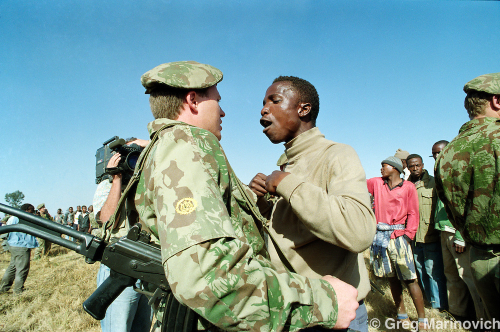 20 June 1992 Boipatong, South Africa A township resident confronts a policeman shortly before police opened fire on a crowd and killed at least one and injured several in Boipatong, Saturday, June 20, 1992.  The shootings followed an aborted visit by South African president F.W. de Klerk to the scene of Wednesday's massacre that left 39 people dead.