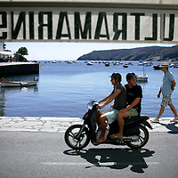 20110913 - Cadaques,  - Two men ride a scooter in Cadaques, Spain.  Photo by Matthew Healey
