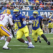 Delaware running back Kareem Williams (32) gains 2 yards during a week nine Colonial Athletic Association Conference game between the Delaware Blue Hens and the Albany Great Danes Saturday, Nov. 07, 2015 at Tubby Raymond Field at Delaware Stadium in Newark, DE.