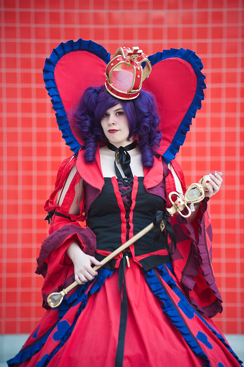 London, UK - 26 May 2013: Michelle Faber dressed as Vivaldi Queen of Hearts from Alice in the Country of Hearts poses for a picture during the London Comic Con 2013 at Excel London. London Comic Con is the UK's largest event dedicated to pop culture attracting thousands of artists, celebrities and fans of comic books, animes and movie memorabilia.