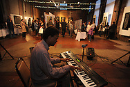 "Bill Perry Jr. plays keyboards at the Yoknapatawpha Arts Council's ""Art For Everyone"" fundraiser in Oxford, Miss. on Tuesday, October 18, 2011."