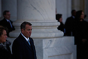 Congressional majority leader John Boehner watches President Barack Obama leave the US Capitol during the inauguration, January 21, 2013 in Washington, D.C.