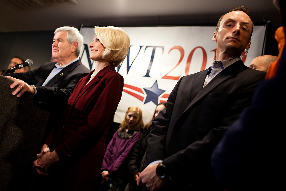 A security guard keeps watch as Republican presidential candidate Newt Gingrich speaks at Tish's Restaurant on Saturday, December 31, 2011 in Council Bluffs, IA.