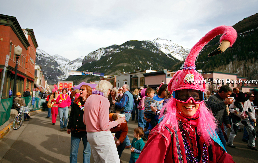 SHOT 4/8/2007 - Dressed up in the spirit of the event a party goer participates in the KOTO Pink Flamingo End of the Season Street Dance on Friday April 6, 2007 in Telluride, Co. The street dance and party held in downtown Telluride celebrates the closing of the ski area and features music by Ralph Dinosaur and his Fabulous Volcanoes, dancing and plenty of pink costumes. It is an annual tradition that has been taking place for more than 25 years..(Photo by Marc Piscotty © 2007)