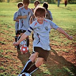Soccer players taking shots on goalie