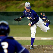 James Branaman  |  Kitsap Sun&amp;#xA;North Kitsap's Jordan Tucker looses his hat while pitching against the Bainbridge Spartans.<br />