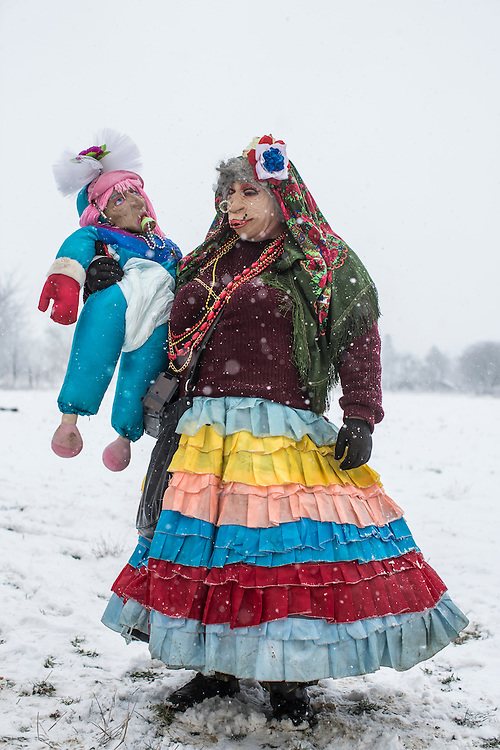 Grygory Pleshka, 28,  dressed in the costume of a mother with a baby, poses for a portrait during celebrations of the Malanka Festival on Thursday, January 14, 2016 in Krasnoilsk, Ukraine. The annual celebrations, which consist of costumed villagers going in a group from house to house singing, playing music, and performing skits, began the previous sundown, went all night, and will last until evening. According to tradition, married men are only able to take part in Malanka wearing a mask.