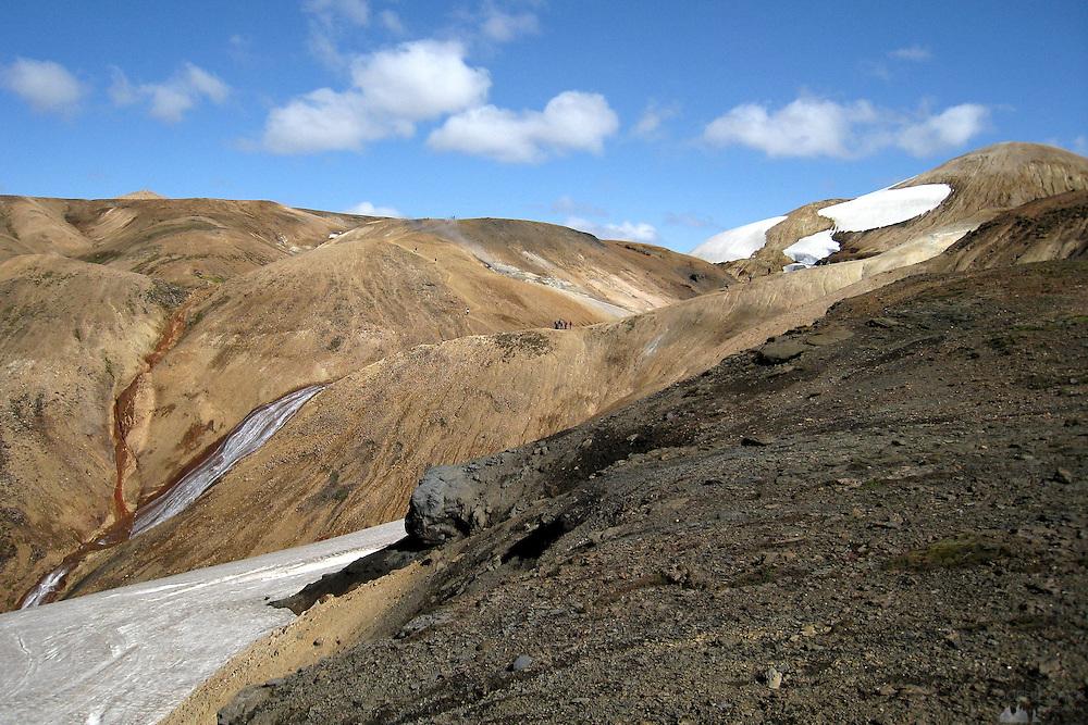 Hiking through rhyolitic hills on the Laugavegur trail between Hrafntinnusker and Álftavatn, southern Iceland