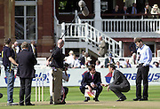 Photo Peter Spurrier.31/08/2002.Cheltenham & Gloucester Trophy Final - Lords.Somerset C.C vs YorkshireC.C..Chanel 4 pitch inspection party left to right Mark Nicklas and Nasser Hussian (crouched) and Michael Atherton standing.