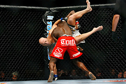 August 9, 2008; Minneapolis, MN, USA;  Cheick Kongo (red trunks) and Dan Evensen (white trunks) battle during their bout at the Target Center in Minneapolis, MN at UFC 87: Seek and Destroy.  Kongo won via 1st round KO.