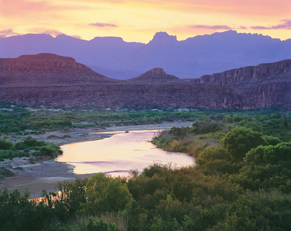 0501-1006LVT ~ Copyright: George H. H. Huey ~ The Rio Grande and Chisos Mountains at dusk.  Chihuahuan Desert.  Big Bend National Park, Texas.