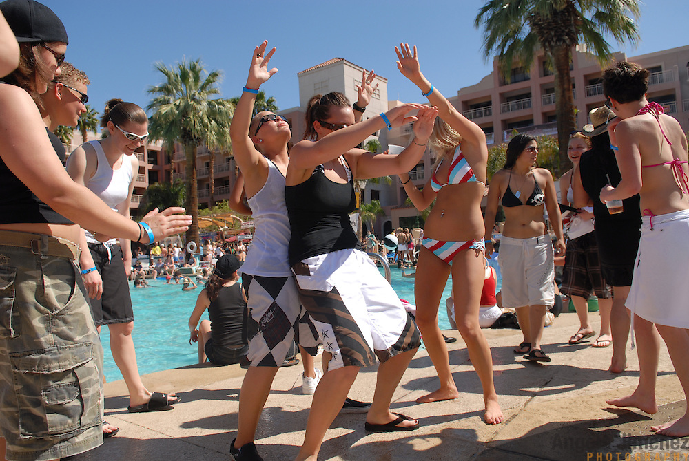 Women gather at a pool party sponsored by the Girlbar and Club Skirts lesbian party promotion companies at the Wyndham Palm Springs hotel in Palm Springs, California on March 30, 2007, the third of five days of parties during the Dinah Shore weekend, an annual lesbian gathering run simultaneously with the Kraft Nabisco Championship LPGA golf tournament.