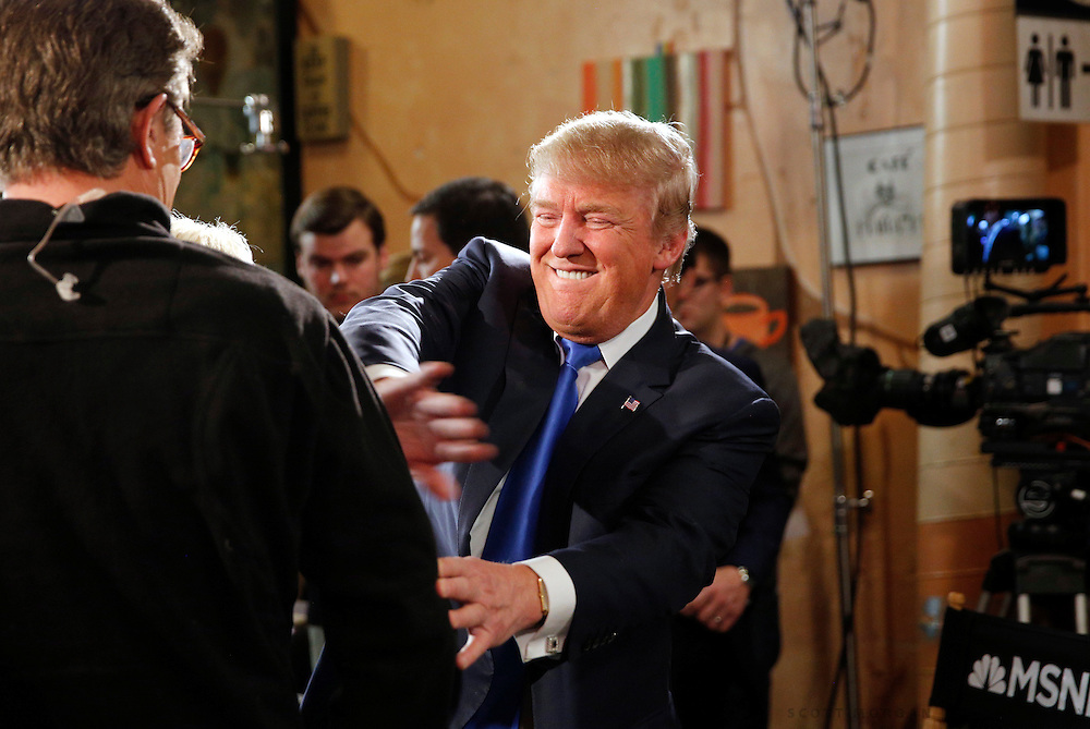 Republican U.S. presidential candidate Donald Trump talks to host Joe Scarborough after an appearance on MSNBC's Morning Joe cable television show at Java Joe's CoffeeHouse in Des Moines, Iowa, January 15, 2016. REUTERS/Scott Morgan